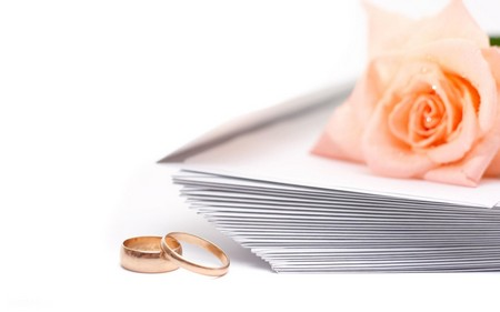 Rose, envelopes and wedding rings on a white background